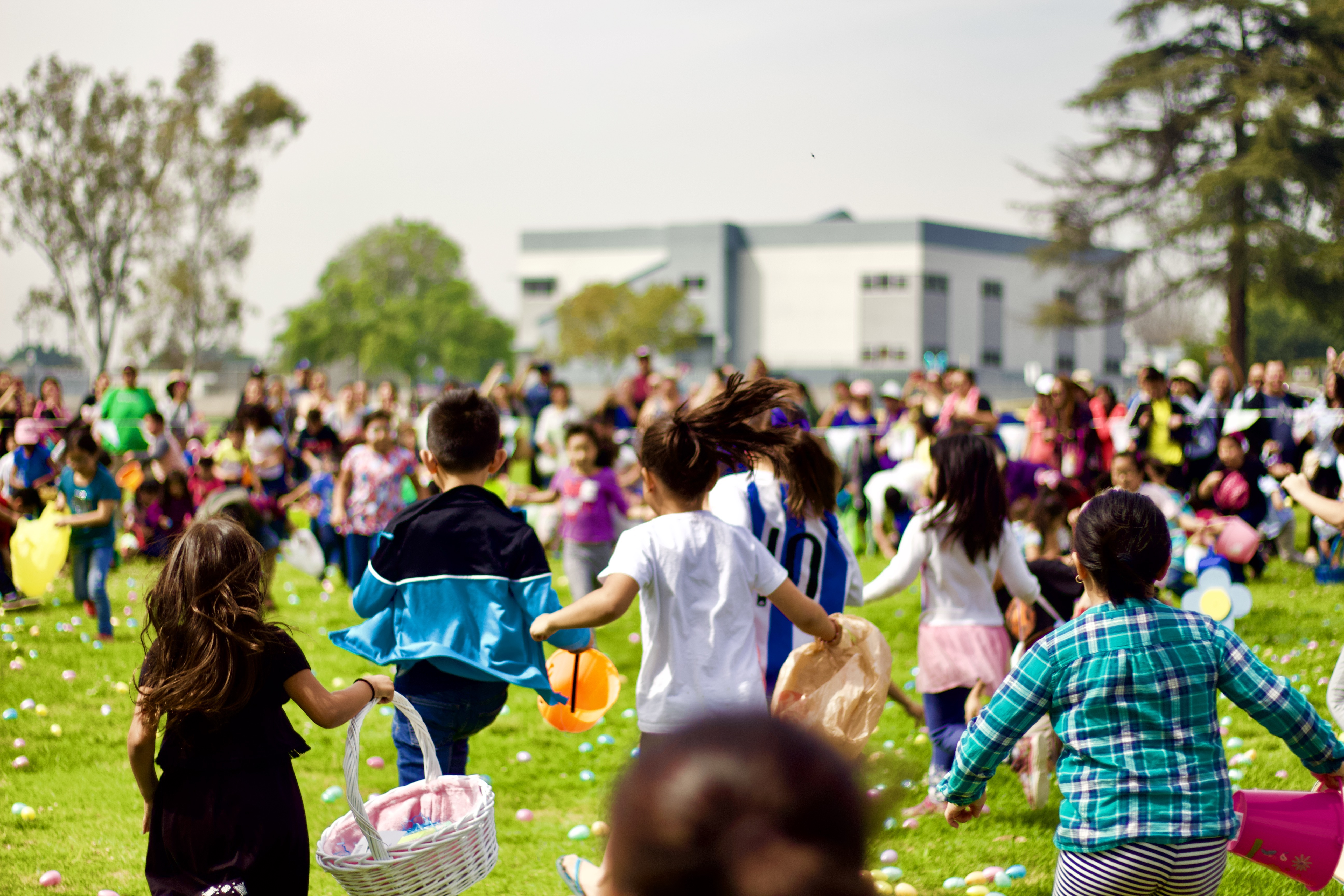 Image of children running in park for the egg hung