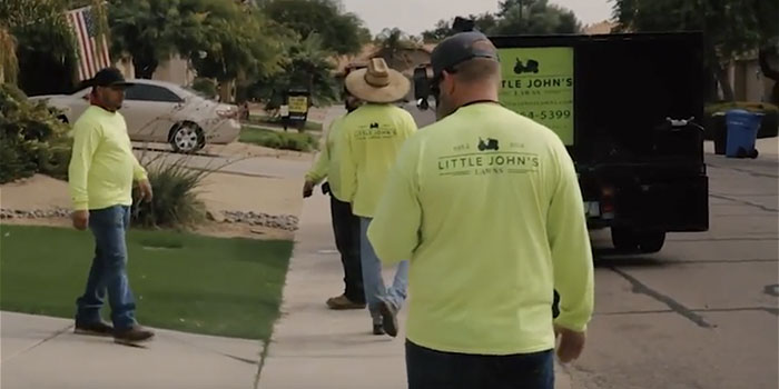 Little John's Lawns crew about to get in the truck after completing a job.