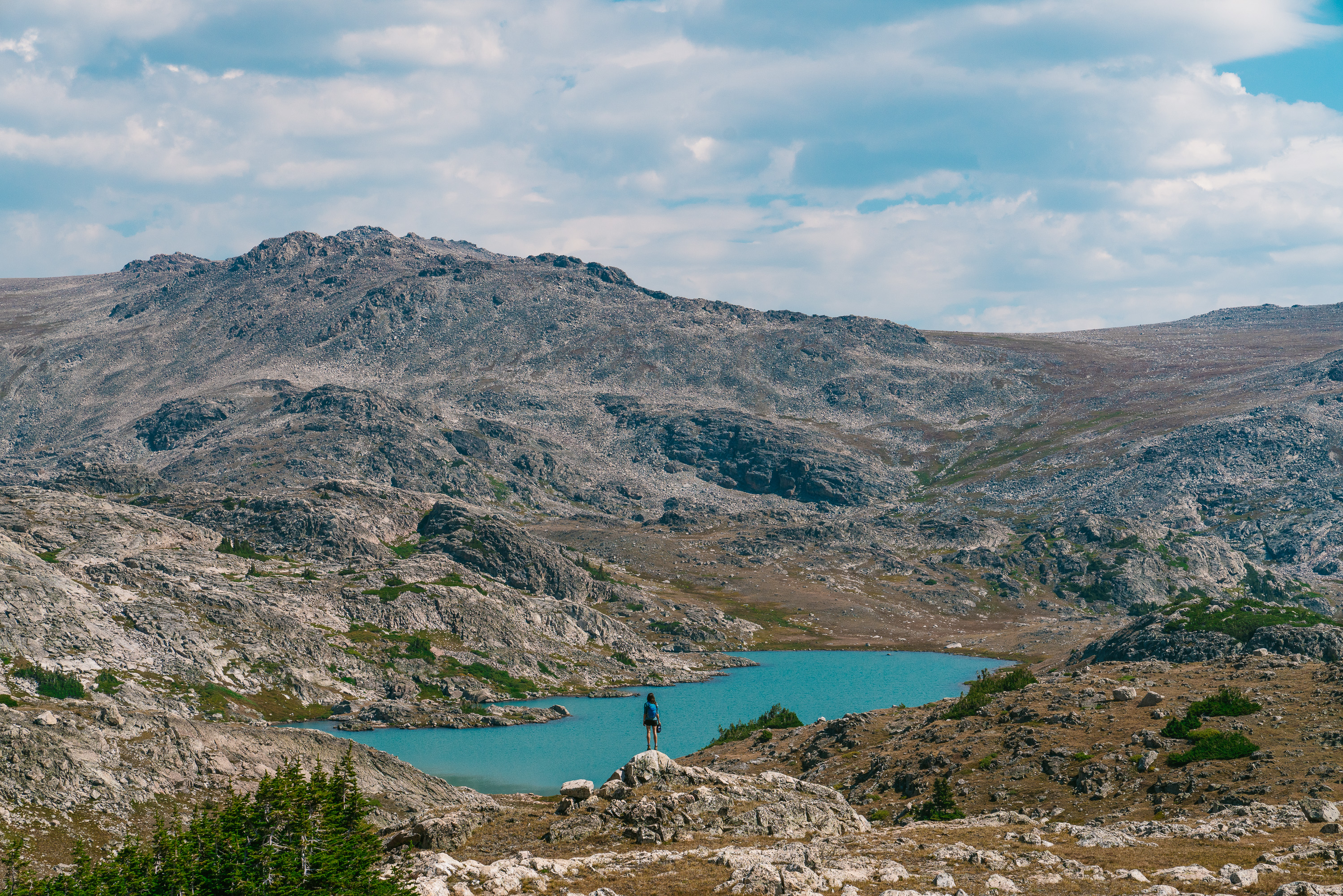 Photo of girl in wyoming mountain andcape with bright blue lake