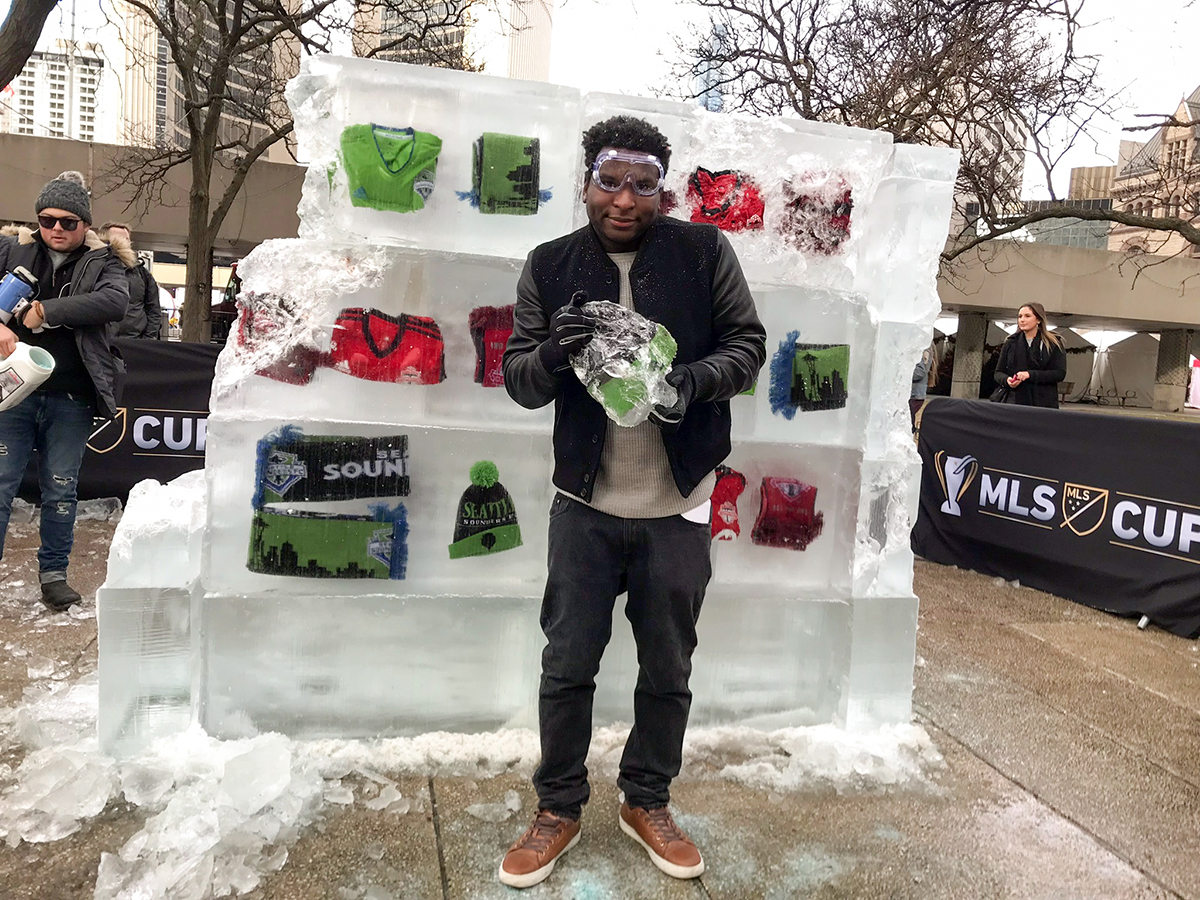CUP17-Man Holding Ice Block in Front