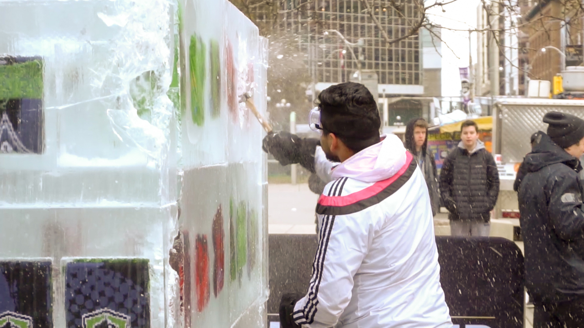 CUP17-Guy Smashing Ice from Side