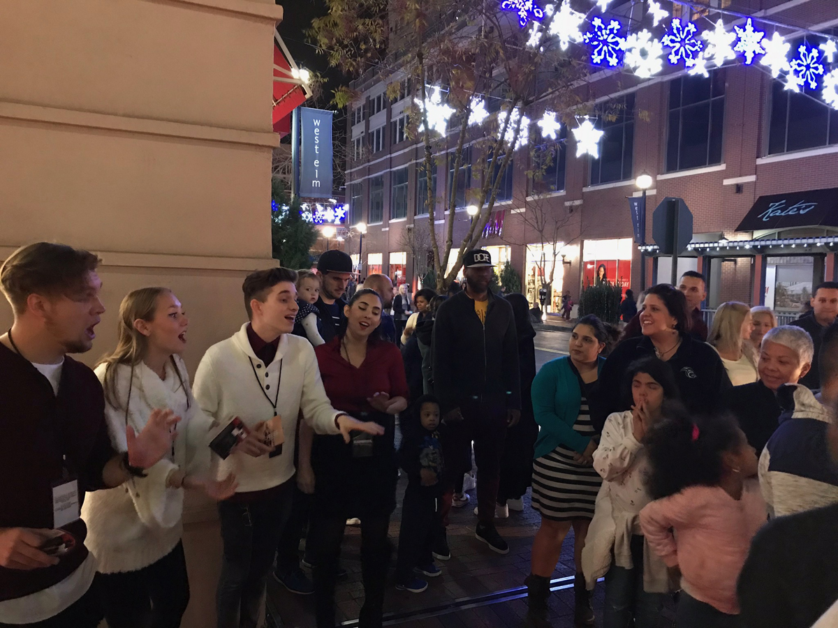 EXP-Staffing-Hip Carolers-Singing in front of store