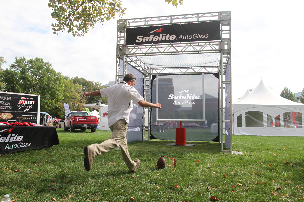 Safelite-Man Kicking into Goal