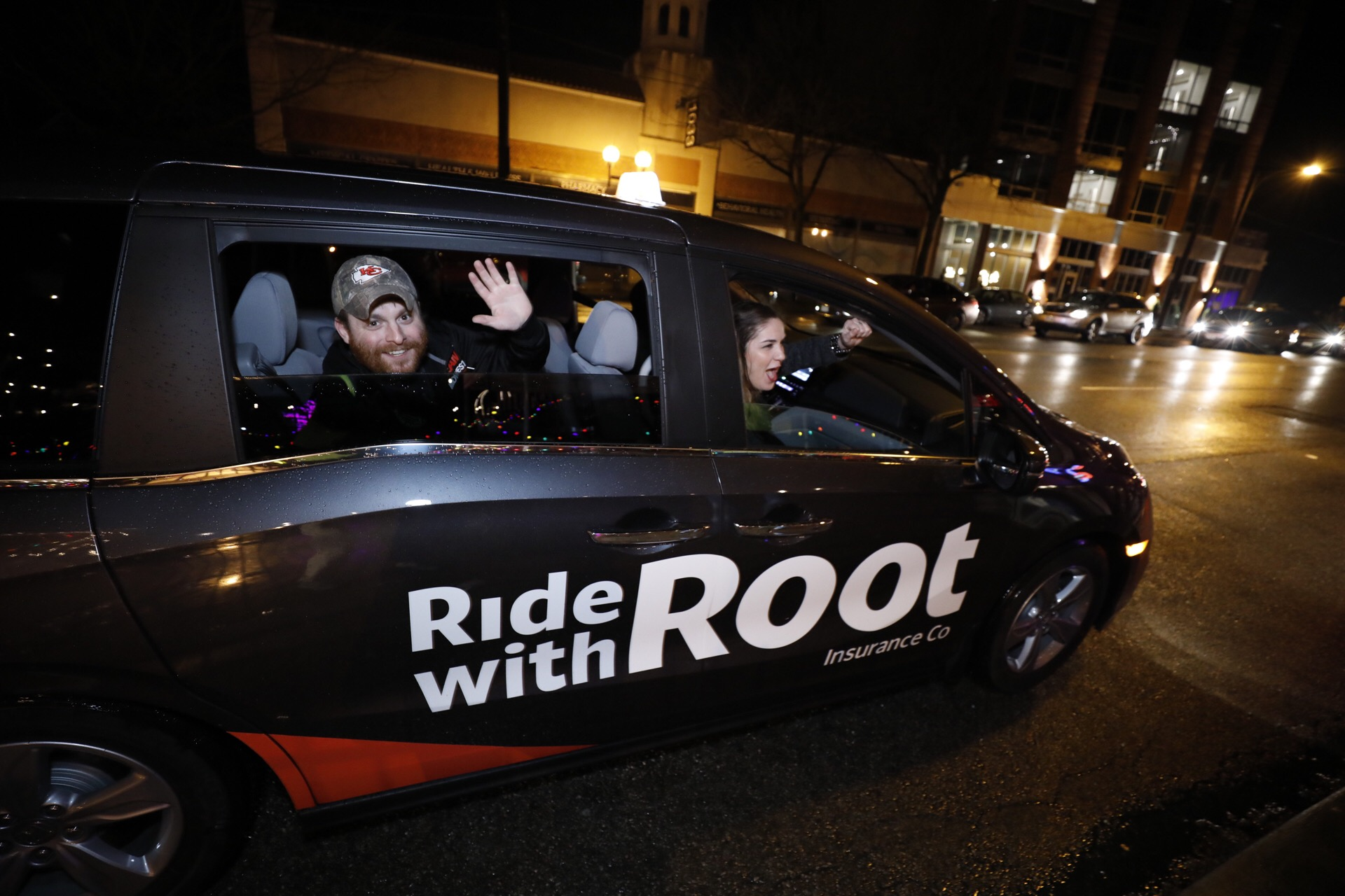 Ride with Root - People in Car Waving