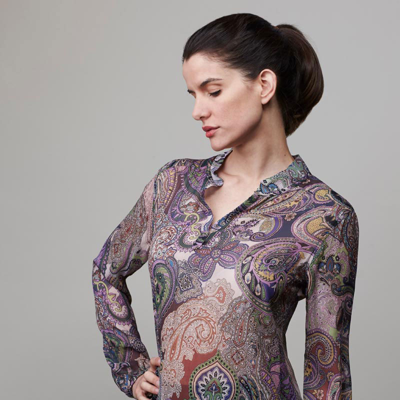 Model wearing lavender paisley top