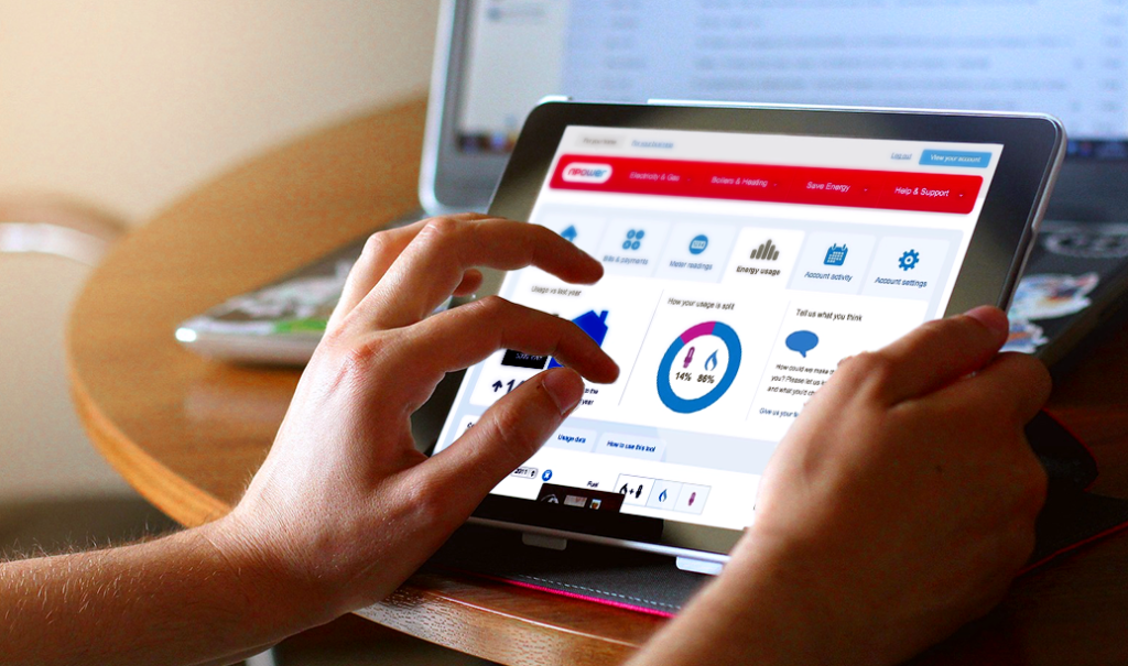 A person interacting with the npower energy tracker on an iPad
