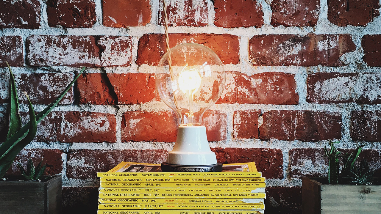 lamp in front of brick wall
