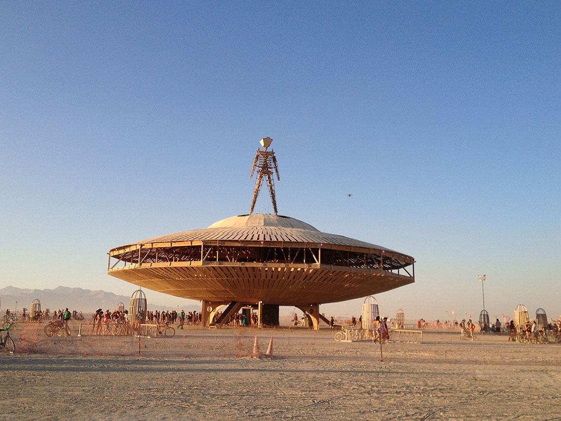 spaceship sculpture with alien sculpture on top