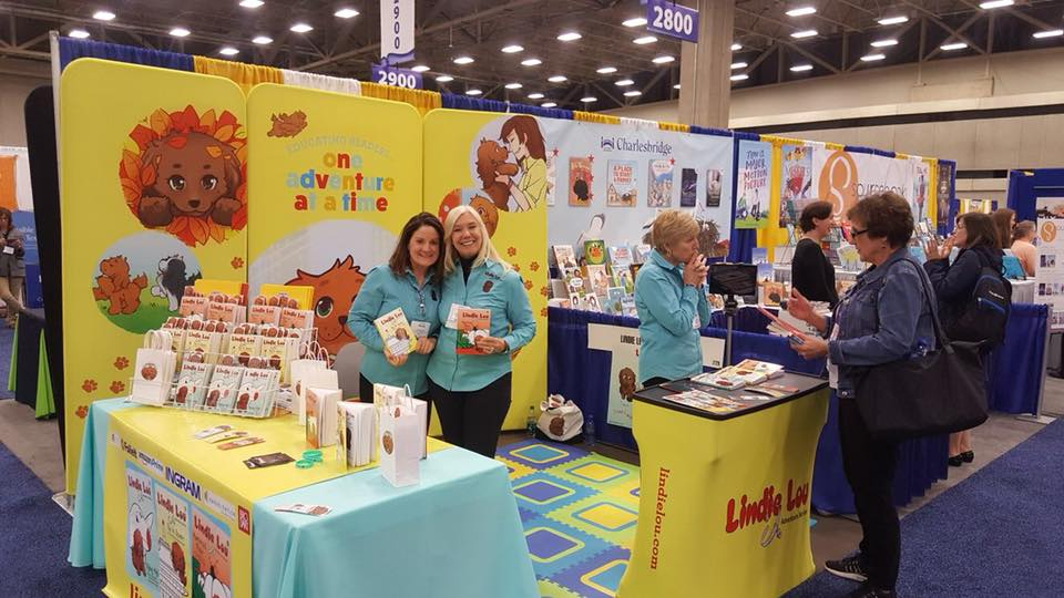 Booth example has table for books and a small info counter for conversation, Lindie Lou Adventure Series, MODdisplays