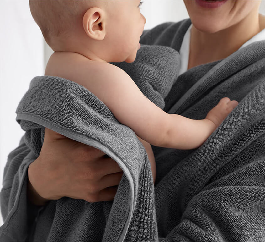 Woman and child wrapped in towel