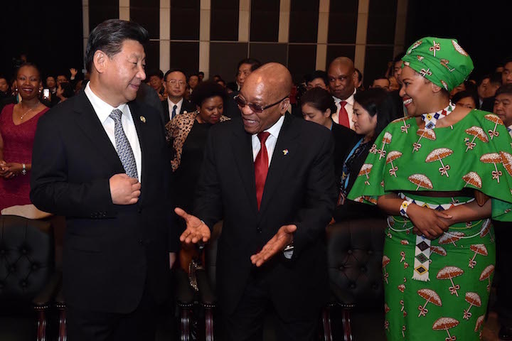 China's President Xi Jinping and Zimbabwe's President Jacob Zuma and his wife converse at the 2015 Forum on China-Africa Cooperation (FOCAC) in Sandton, Johannesburg. Photo by GCIS, licensed under (CC BY-ND 2.0).