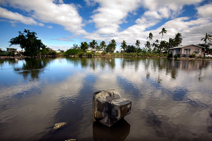 Properties built in a flood-prone area in Tonga, a low-lying island nation in the South Pacific vulnerable to rising sea levels. Photo by Asian Development Bank, licensed under (CC BY-NC-ND 2.0).