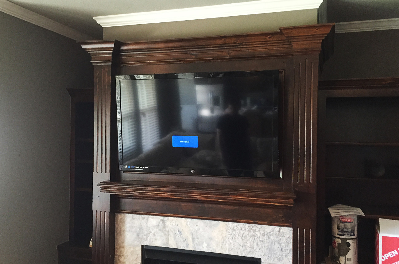 Wood Fireplace Mantle TV
