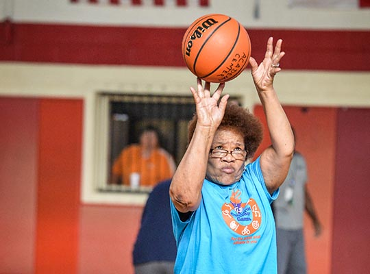 Senior Shooting a Basketball