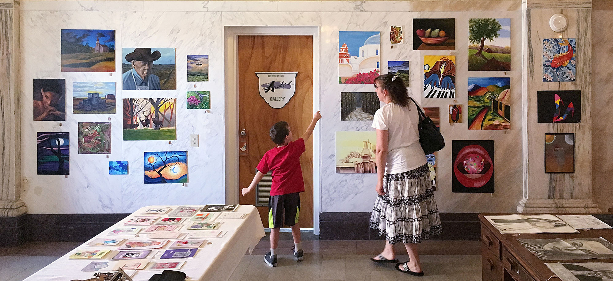 A family looks at artwork on display at Artel Gallery in Pensacola, FL.