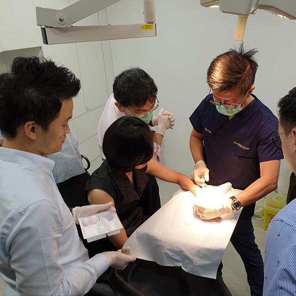 "Dr Ivan Puah training other doctors during the filler workshop called, ""Radiesse BioStimulation"" in July 2019."