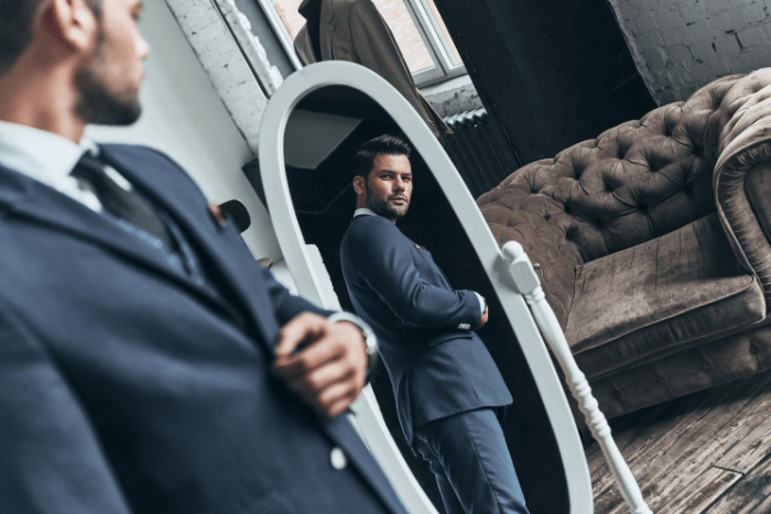 Common Male Body Image Issues - Man Looking In Mirror