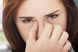 Woman suffering from discomfort of nasal polyps