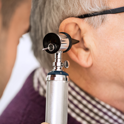Photo Of Doctor Checking a patients ear