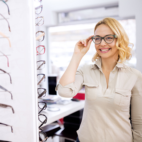 Image of a woman trying on a pair of eyeglasses