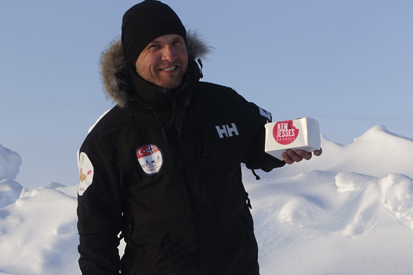 Man holding Ken and jesse box in snow