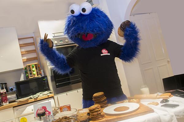 Cookie monster holding cookies