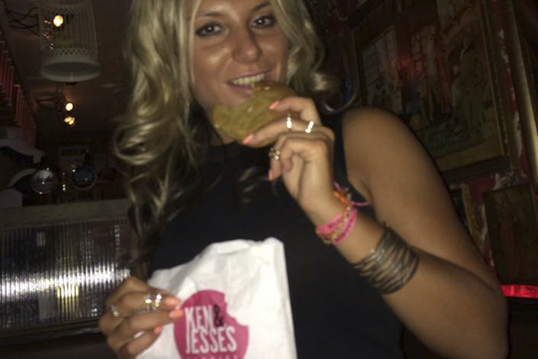 Lady eating cookie
