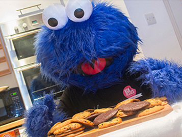 Cookie monster with cookies in front