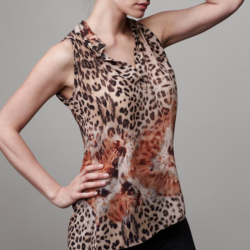 Front of model wearing leopard blouse