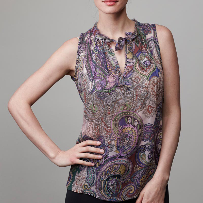Front of model wearing paisley top