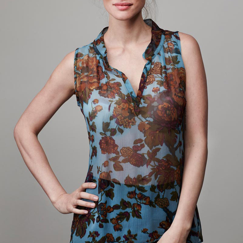 Front of model wearing top with botanical pattern