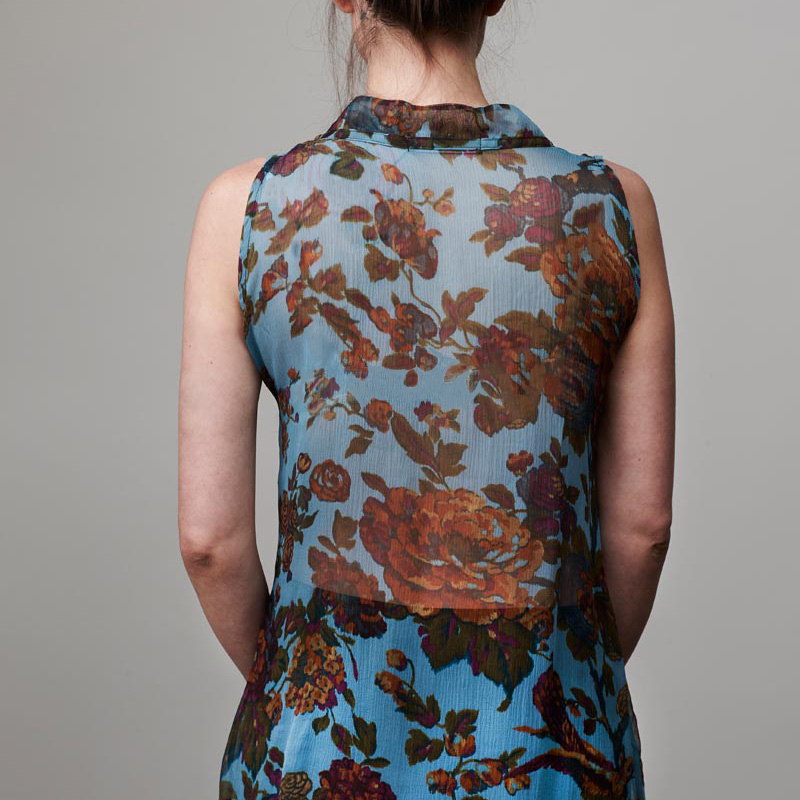 Back of model wearing top with botanical pattern