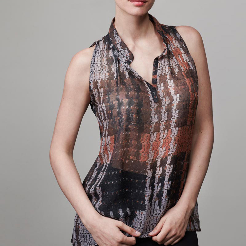 Front of model wearing a patterned blouse