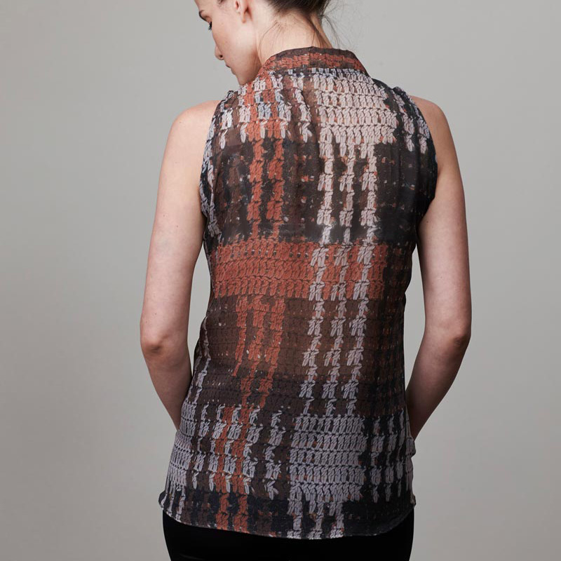 Back of model wearing a patterned blouse
