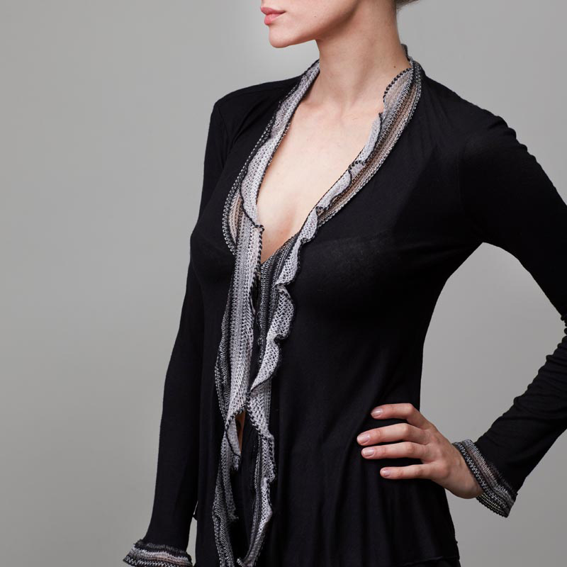 Front of model wearing black cardigan