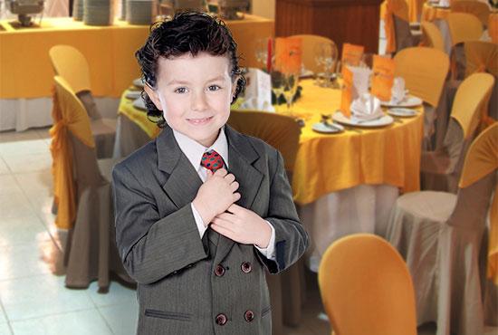 Boy in suit fixing his tie in restaurant