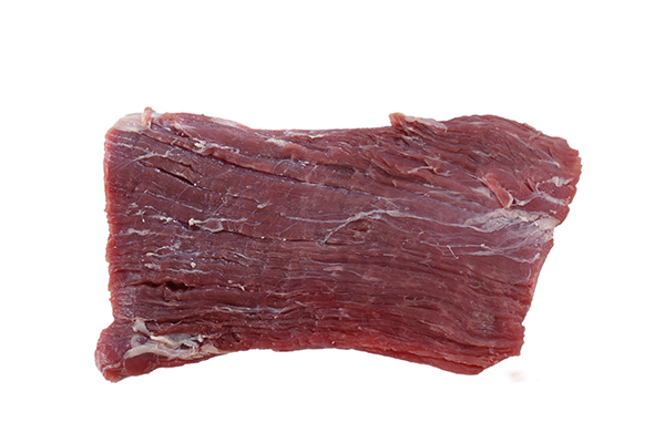 Raw London Broil beef for use in cooking custom homemade dog food.