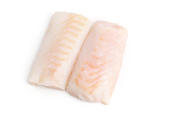 Raw cod filets for use in cooking custom homemade dog food.