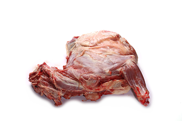 Raw goat meat for use in cooking custom homemade dog food.