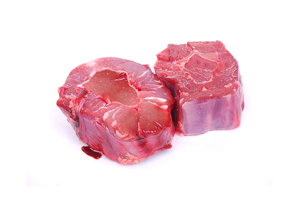 Raw ostrich meat cut up for use in cooking custom homemade dog food.
