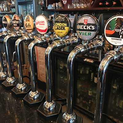 row of beer pumps on bar