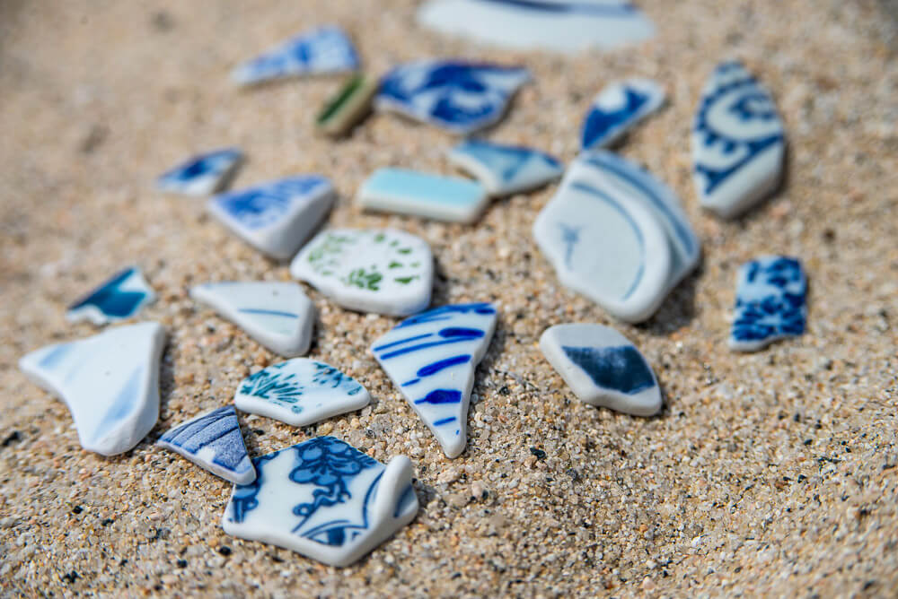 Broken pieces of Japanese teaware that can be found all along the beach
