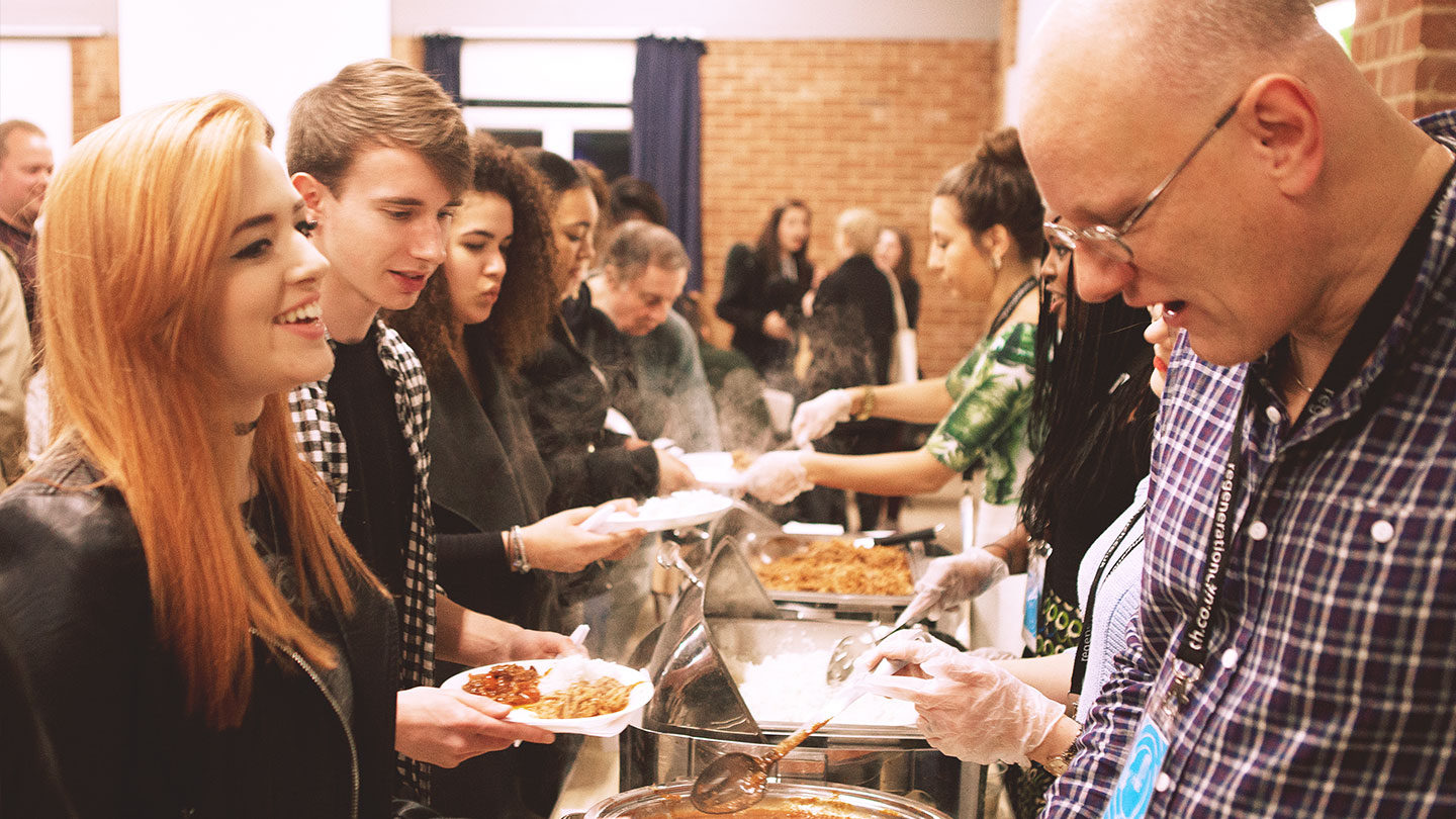 Serving food at a Community Meal