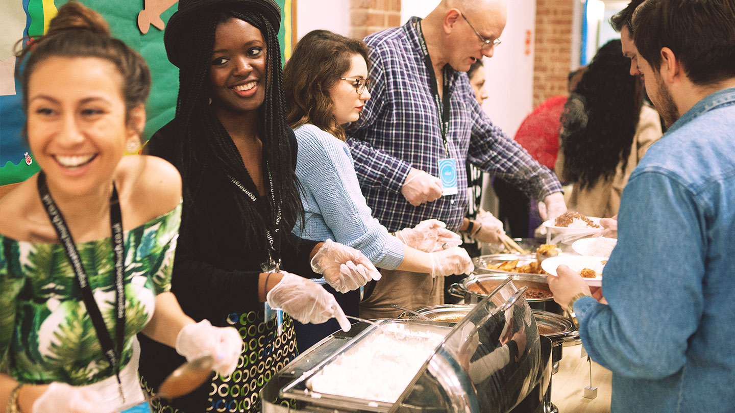 Serving food at the Community Meal