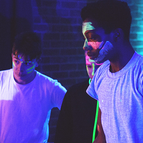 Young people at an Indigo neon party