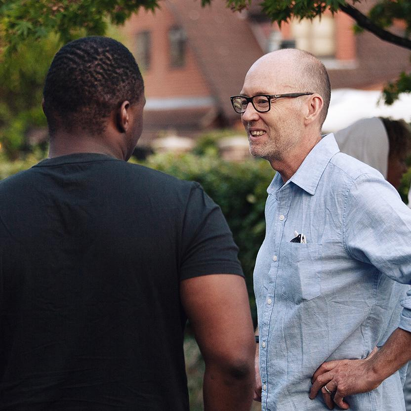 Two men enjoying a conversation outside