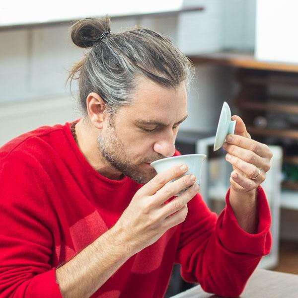 Man sniffing some tea