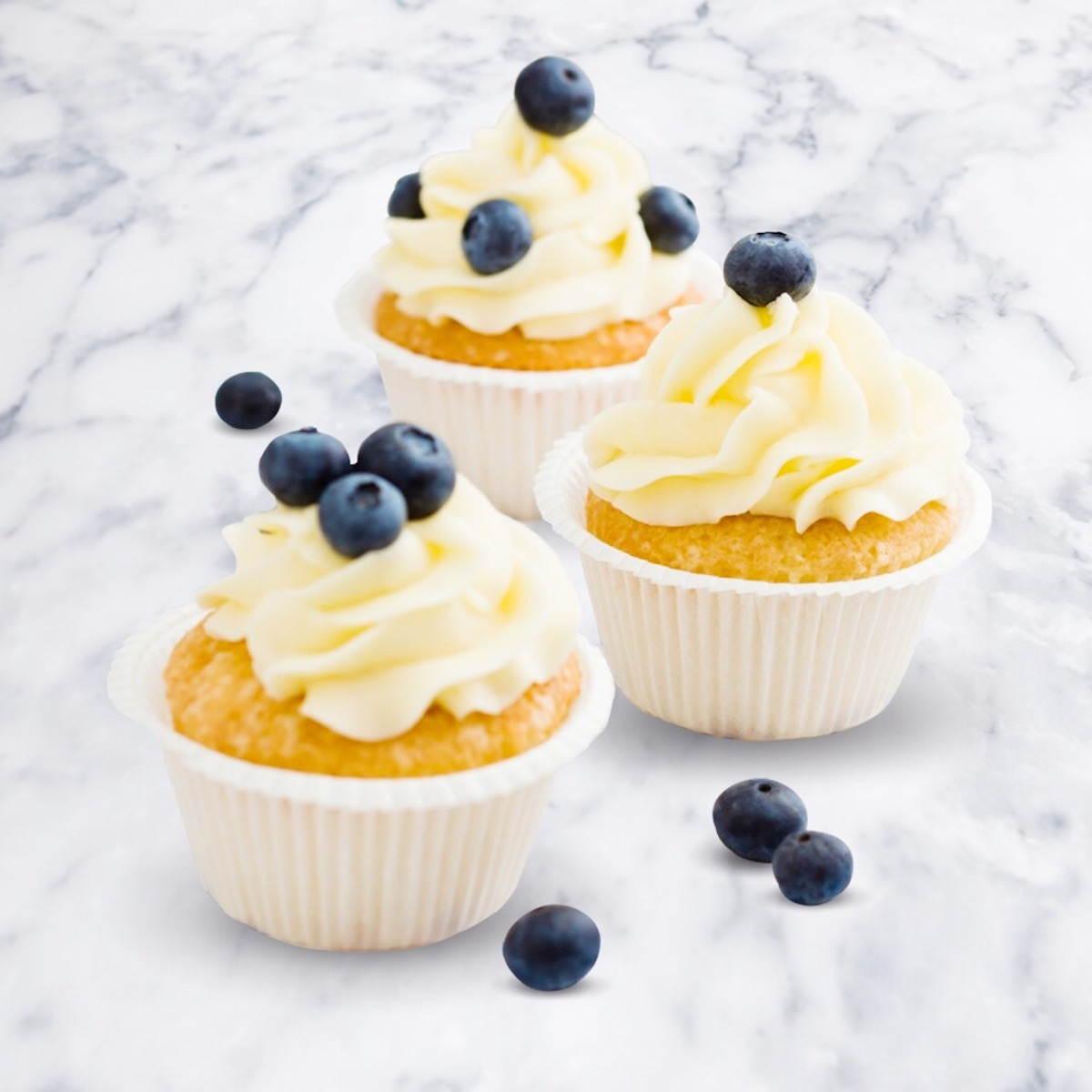 Lemon Cupcakes with a Blueberry Buttercream