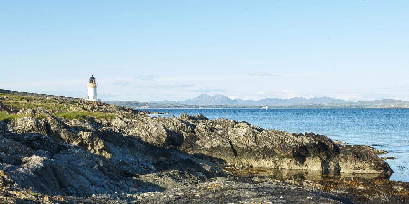 Lighthouse at Port Charlotte, with views towards Jura. Original image courtesy Benoit Plumat