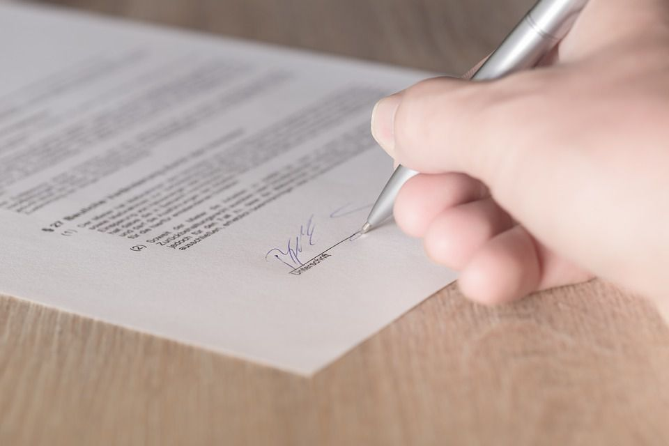 What is the difference between a revocable living trust and a will?